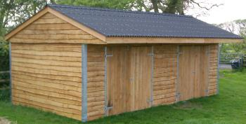 24 x 12 mobile field shelter with 2 x 7ft openings each fitted with full height double doors.