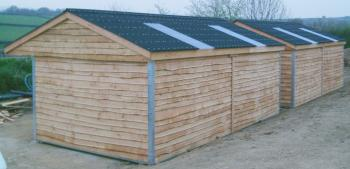 24 x 12 mobile field shelters partitioned to give 2 x 12 x 12 stables in each fitted with a clear roofing sheet in each box.